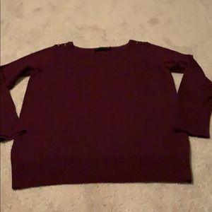 Burgundy long sleeve sweater.